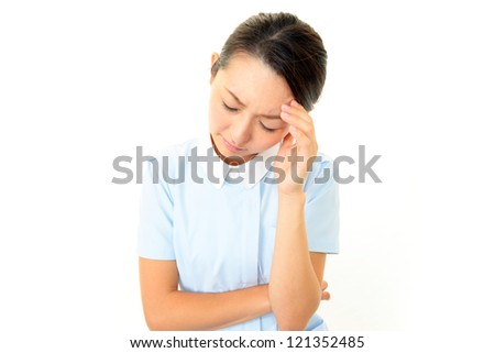 Stressed Asian female nurse