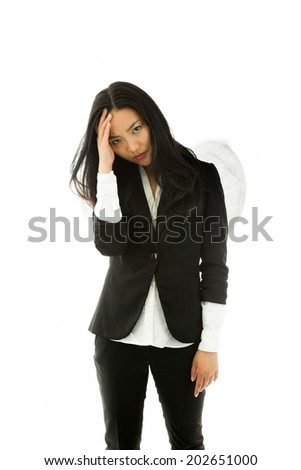 Stressed Asian young businesswoman dressed up as an angel suffering from headache isolated on white background