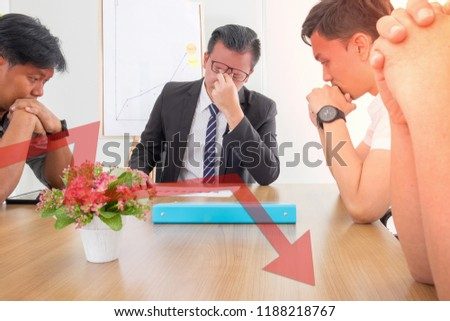 Stressed boss and team with problem business at meeting. red color heads and sad eye depressed by failure.Red arrow down is financial crisis.