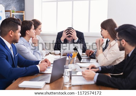 Stressed boss having problem at business meeting in office