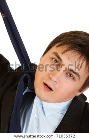 Stressed businessman hanging himself on his necktie isolated on white
