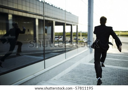 stressed businessman running away