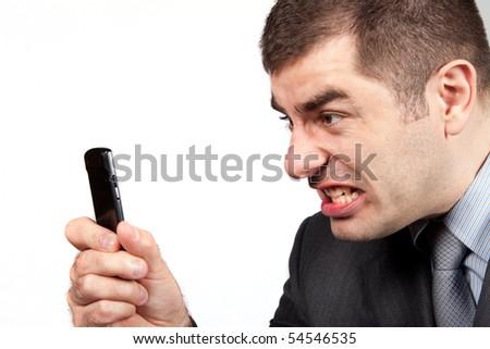 stressed businessman screaming in telephone