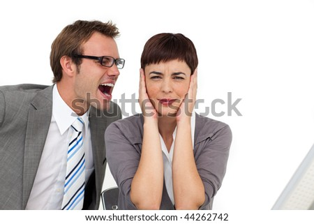 Stressed businessman shouting into his colleague's ear in the office