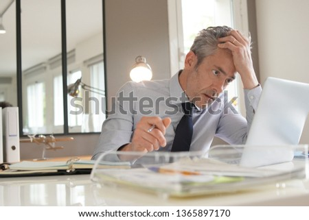 Stressed businessman working in contemporary office Сток-фото ©