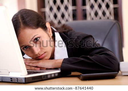 Stressed businesswoman at work