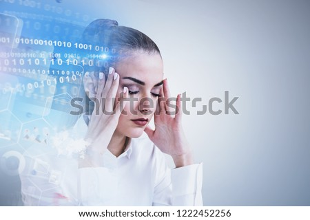 Stressed businesswoman portrait near gray wall with binary numbers interface and business infographics. Concept of too much information. Toned image double exposure mock up #1222452256
