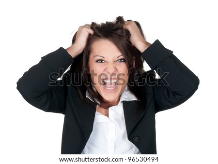 stressed businesswoman ruffles her hair
