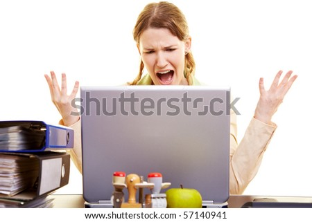 Stressed businesswoman shouting loudly at her laptop