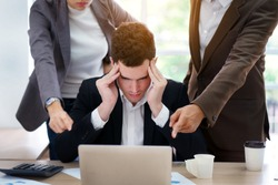 Stressed Caucasian businessman getting trouble from mistake. Corporate colleague pushing new business project planning. Teamwork planners have conflict of interest between partner and coworker