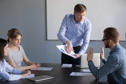 Stressed employee disagreeing with boss blaming for mistake in financial report, dissatisfied ceo team leader arguing with worker about bad work charging fault upon duties failure or demanding result