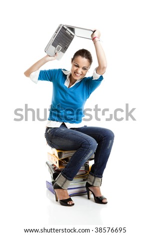 Stressed female student throwing out a laptop, isolated on white