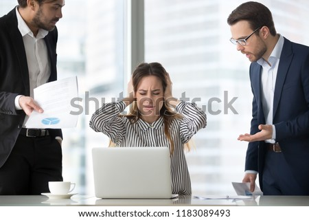 Stressed frustrated female CEO or boss closing ears abstracting from annoying colleagues or subordinates, woman feeling despair avoiding bothering clients, ignoring solving problems, do not want work