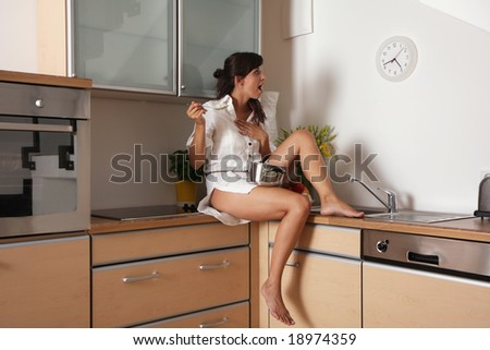 Stressed housewife woman at home looking on the clock