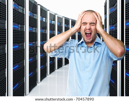 stressed man and datacenter with lots of server