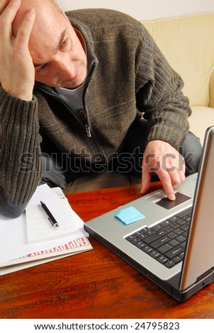 Stressed man is looking on-line for a job
