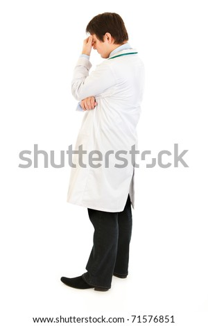 Stressed medical doctor holding fingers at noseband isolated on white