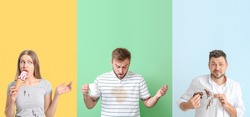 Stressed people with stains on their clothes against color background