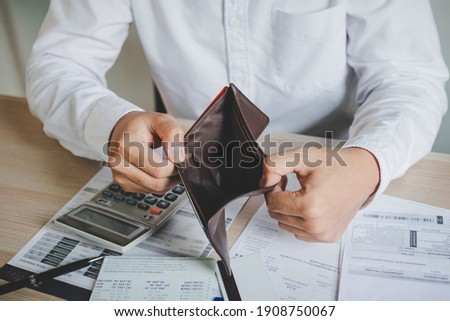 Stressed, Problem business person man, male holding and open an empty wallet not have money, credit card, not to payment bill, loan or expense in pay. Bankruptcy, bankrupt and debt financial concept. Stock photo ©