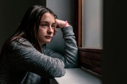 Stressed sad young woman having mental problems, feeling bad, need psychological help, addicted heartbroken girl experiencing adolescence crisis. sad teenage girl looking thoughtful about troubles
