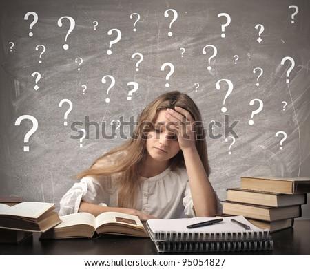 Stressed teenage girl doing her homework