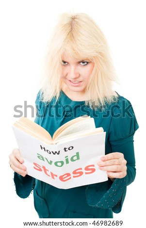 Stressed woman with tousle try to avoid stress reading book about it with angry face