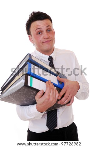 stressed young businessman with ring binders