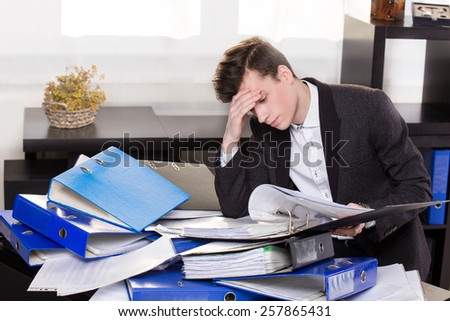 Stressful business man have so many paperwork in the office