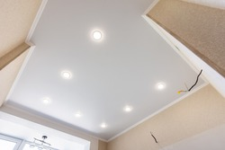Stretch ceiling in the kitchen with installed and included spotlights