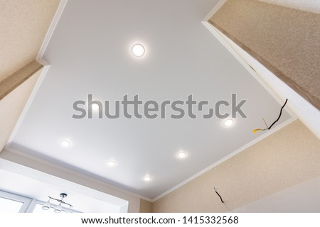 Photo of  Stretch ceiling in the kitchen with installed and included spotlights