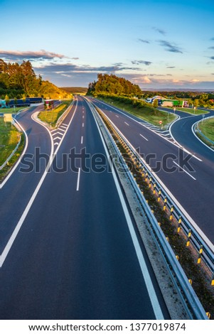 stretch of motorway in Germany by setting sun #1377019874