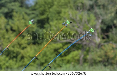 stretched fishing line on a fishing rod with a bell closeup #205732678
