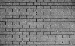 Stretcher bond type brick wall in black and white photo, paving stones pattern, colorless background
