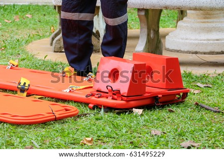 stretcher for emergency paramedic service medical equipment on lawn background #631495229