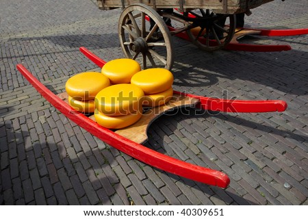 Stretcher with cheese in the market area of city Alkmaar, the Netherlands