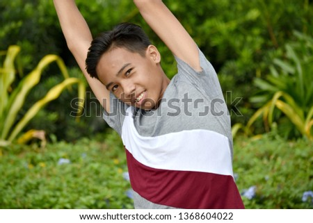 Stretching Good Looking Filipino Teenage Male