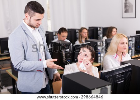 Strict boss and crying european clerk at open space working area