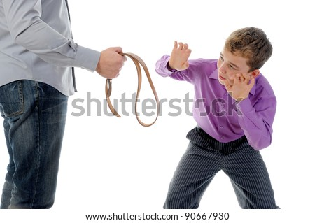 Strict father punishes his son. Isolated on white background