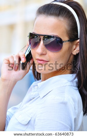 strict woman is looking back and talking phone