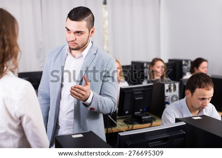 Strict young boss and crying clerk at open space working area