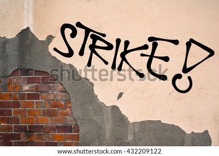 Strike - Handwritten graffiti sprayed on the wall, anarchist aesthetics. Appeal to fight for good conditions for employees at work. Uprising against exploitation