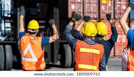 Strike of workers in container yard. Group of multiethnic engineer people during a protest in workplace Stock photo ©