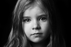 Striking black and white portrait of young girl