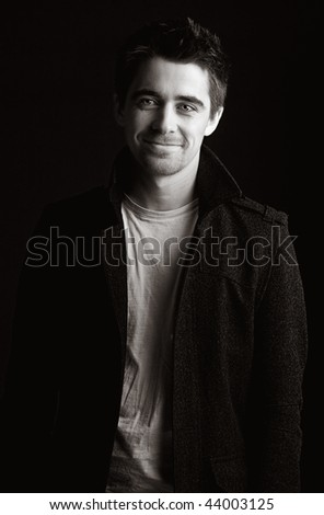 Striking Portrait Shot of a Handsome Dark Haired Male Smiling