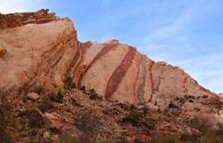 striking red striped  rock wall in uneva canyon in the san rafael swell near green river, utah