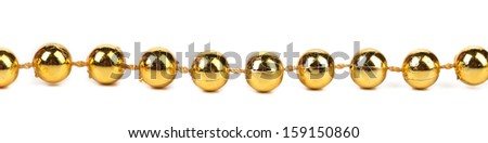 String of golden beads. Isolated on a white background.