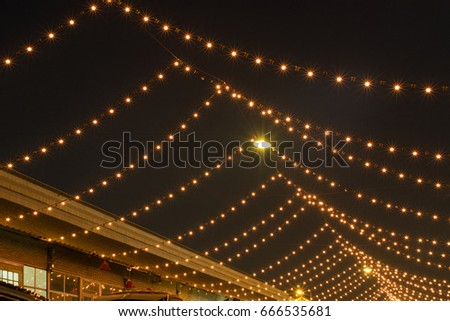 String of Light bulb decor in outdoor party. #666535681