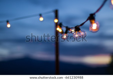String of lights in a Rocky Mountain sunset
