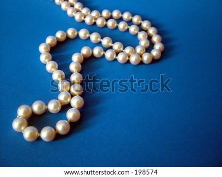 String of pearls on dark blue background