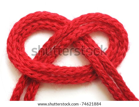 string of red yarn on white background